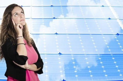 Woman-thinking-and-Solar-PAnels